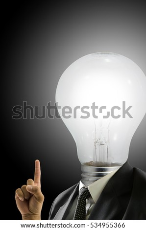 Businessman heads a bulb with fingers pointing up.An idea occurred.