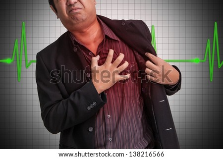 Businessman Heart Attack - stock photo