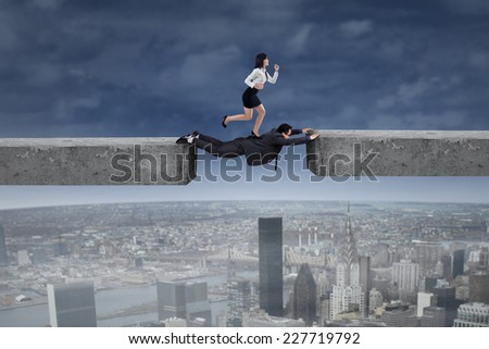 Businessman help his partner to past the gap by forming a bridge - stock photo