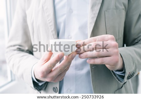 businessman hold a cup of coffee   - stock photo