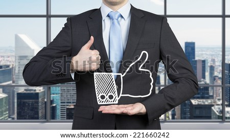 Businessman hold an icon of the successful transaction. - stock photo