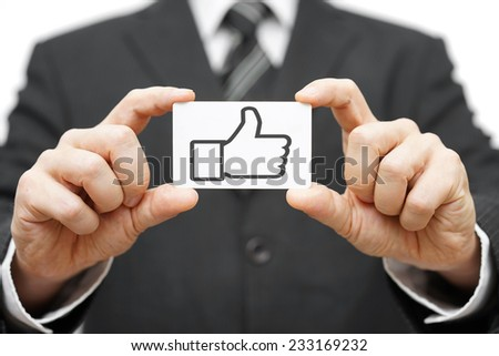 businessman hold business card with thumbs up icon - stock photo