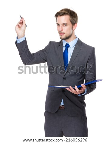 Businessman hold clipboard and pen write on air