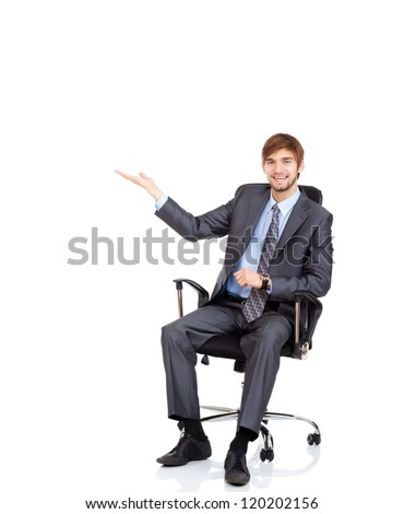 businessman hold hand open palm with empty copy space, sitting in chair happy smile business man showing something on hand gesture, concept of advertisement product isolated over white background - stock photo