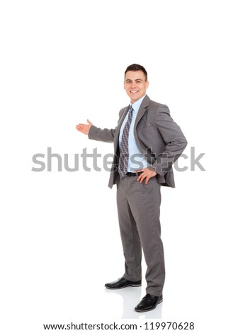 Businessman hold hand welcome gesture, Handsome young business man happy smile showing open palm, concept of advertisement product, empty copy space, full length isolated over white background
