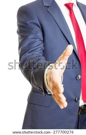 Businessman hold hand welcome gesture, offering a handshake - stock photo