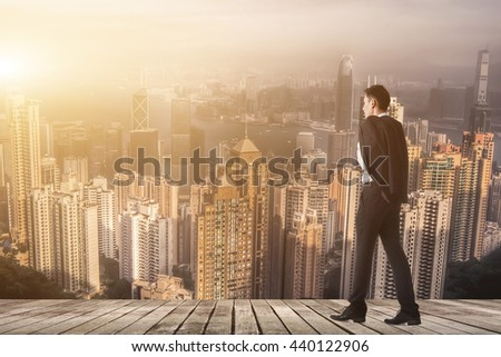 Businessman hold his coat after work and walk to somewhere. - stock photo