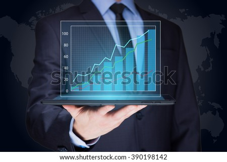 businessman hold tablet with graph on high technology