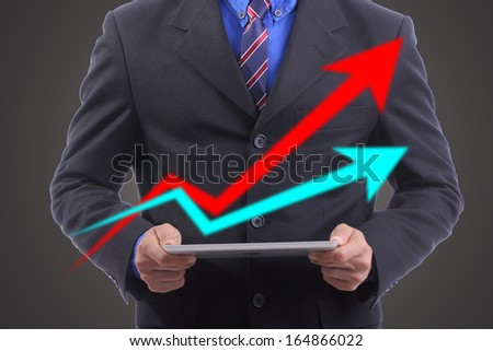 Businessman hold touch pad with growing concept his business