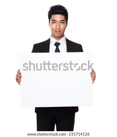 Businessman hold with white card board - stock photo