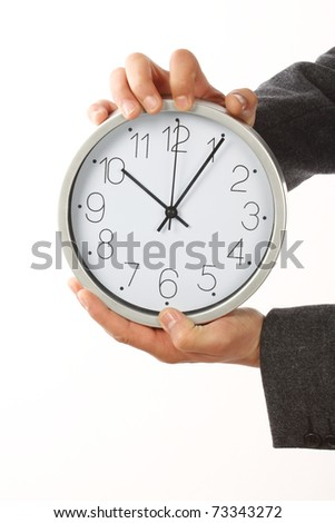 Businessman holding a big clock. Time for  work concept - stock photo