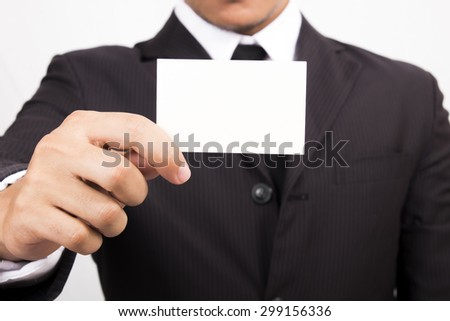 Businessman holding a blank business card .
