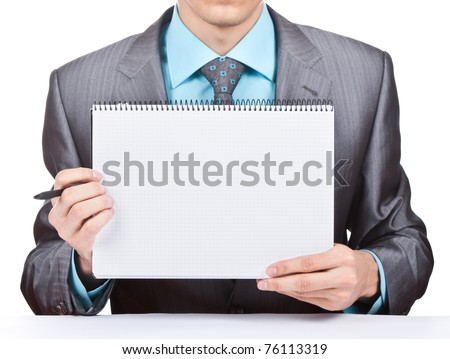businessman holding a blank notepad, white board, signboard, showing an emty bill board against white background - stock photo