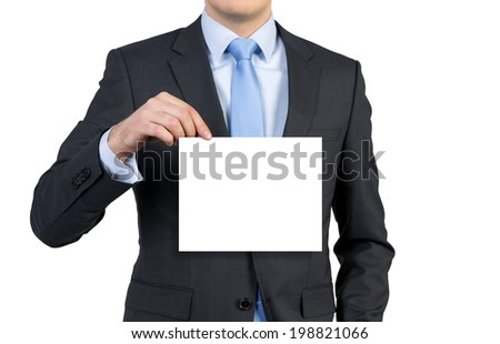 Businessman holding a blank poster