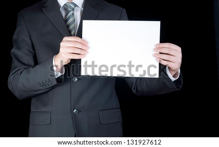 Businessman holding a blank white board. Male hands holding a blank white panel. On a gray background