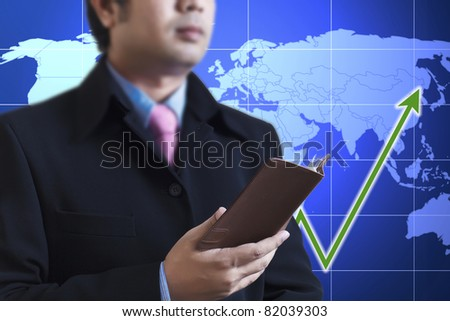 Businessman holding a book in hand : Data source: NASA - stock photo