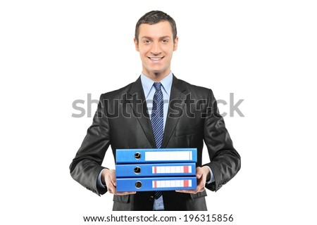 Businessman holding a bunch of folders isolated on white background - stock photo