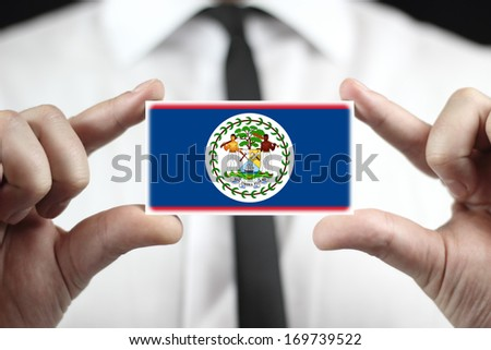 Businessman holding a business card with Belize Flag - stock photo