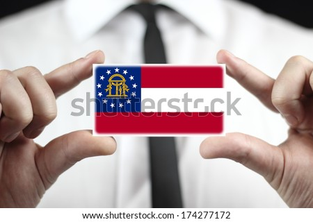Businessman holding a business card with Georgia State Flag