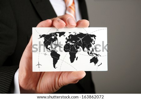 businessman holding a business card with his travel route to his cooperation partners