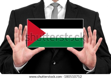 Businessman holding a business card with Palestine Flag - stock photo