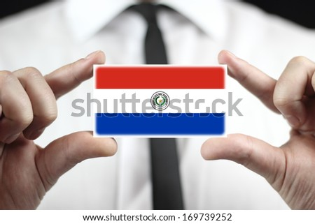 Businessman holding a business card with Paraguay Flag