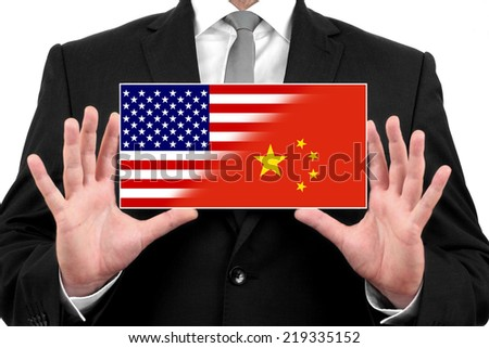 Businessman holding a business card with USA and China Flag - stock photo