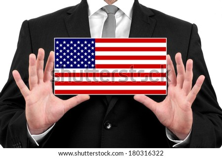 Businessman holding a business card with USA Flag - stock photo