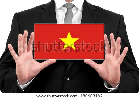 Businessman holding a business card with Vietnam Flag - stock photo