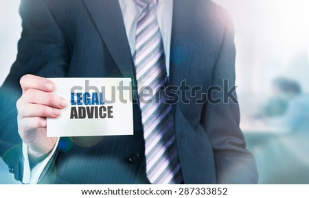 Businessman holding a card with Legal Advice written on it. - stock photo