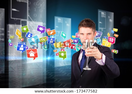 Businessman holding a champagne glass against hologram on black background with hexagon pattern