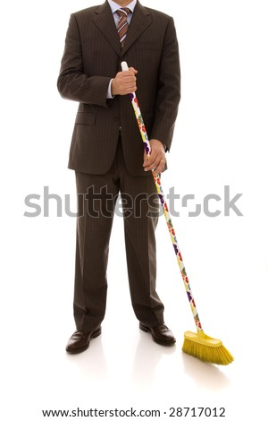 businessman holding a cleaning broom (isolated on white) - stock photo