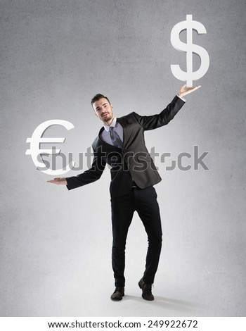 Businessman holding a dollar and euro symbol - stock photo