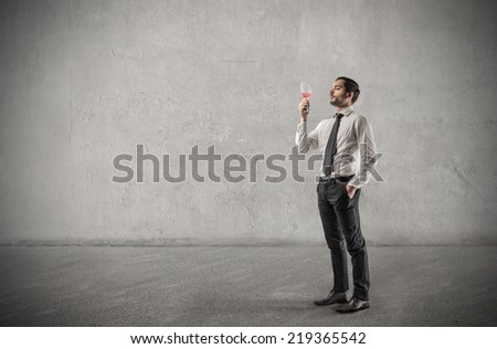 Businessman holding a glass  - stock photo