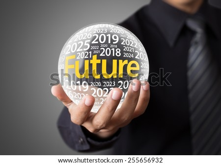 Businessman holding a glass ball,foretelling the future. - stock photo