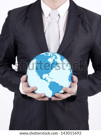 Businessman holding a globe on white background