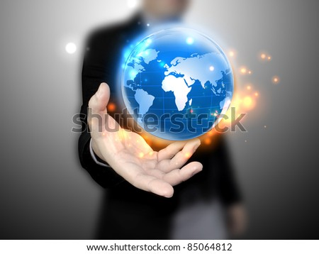 businessman holding a glowing, connected