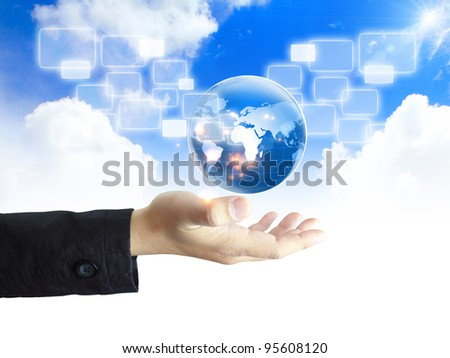 businessman holding a glowing, connected - stock photo