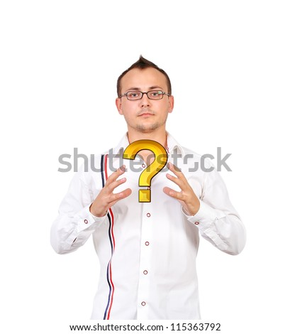 Businessman holding a gold question mark - stock photo