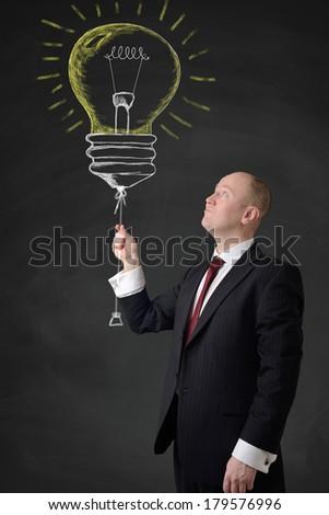 businessman holding a idea bubble - stock photo