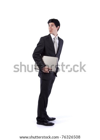 Businessman holding a laptop and looking back (isolated on white) - stock photo