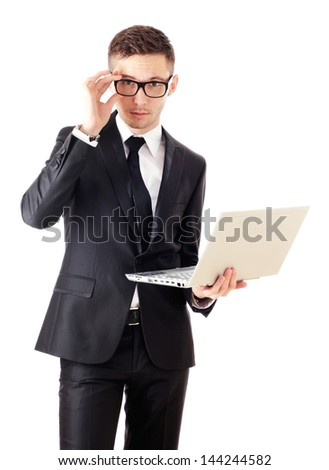 Businessman holding a laptop and looking surprised. Isolated against a white background.