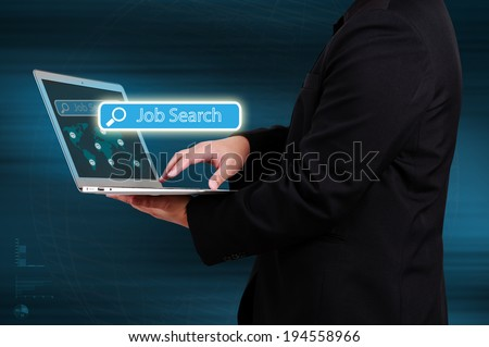 Businessman holding a laptop and showing job search on virtual screen.