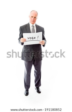 "Businessman holding a message board with the text words ""Vote"" - stock photo"