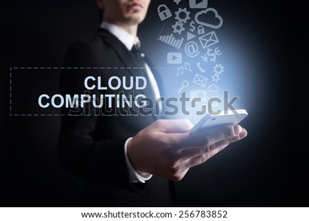 businessman holding a mobile phone cloud with computing text and applications icons. Internet concept. - stock photo