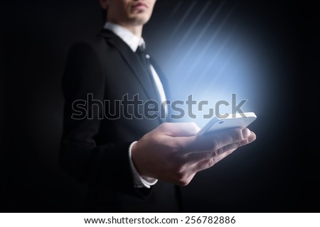 businessman holding a mobile phone  . Internet concept.
