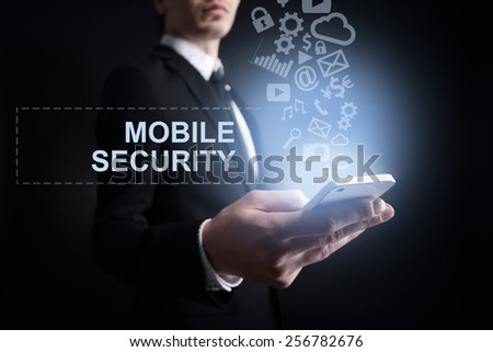 businessman holding a mobile phone with internet and mobile security concept. Internet concept. cyber attack. - stock photo