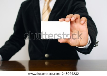 businessman holding a name card - stock photo