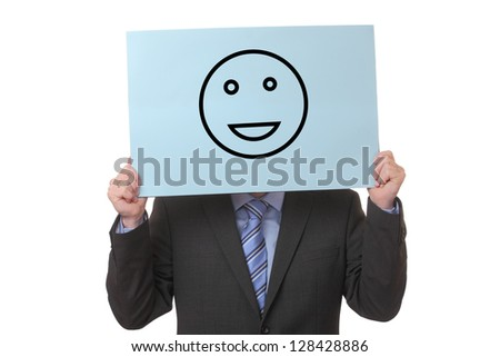 Businessman holding a paper with a positive smiley on white background - stock photo