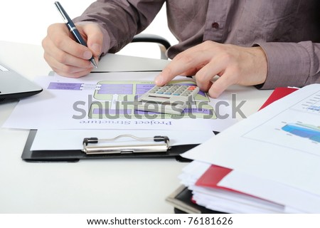 Businessman holding a pen - stock photo